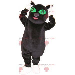 Großes Schwarzweiss-Katzenmaskottchen mit grünen Augen -