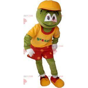 Zelený maskot legrační sněhulák v barevné oblečení -