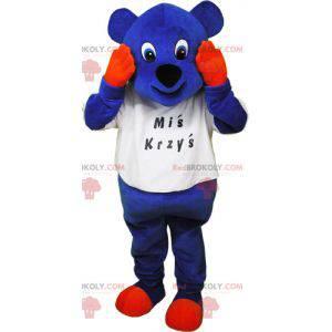 Blaues Bärenmaskottchen mit orangefarbenen Händen und Pfoten -