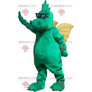 Green dragon mascot with yellow wings and glasses -