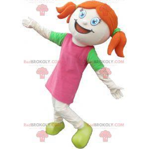 Maskot hezká zrzka dívka oblečená v růžové a zelené -