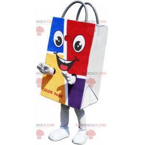 Kolorowa i uśmiechnięta maskotka w papierowej torbie -