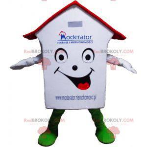 Velmi usměvavý červený a zelený maskot bílého domu -