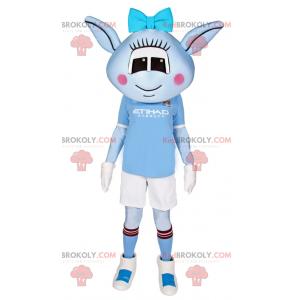 Modrý mimozemský maskot s modrou mašlí a fotbalovým oblečením -