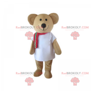 Adorable smiling teddy bear mascot with his red scarf -