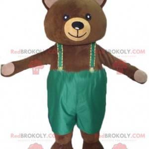 Großes braunes Teddybärmaskottchen mit grünem Overall -