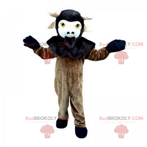 Mascote de cabra preta e marrom - Redbrokoly.com