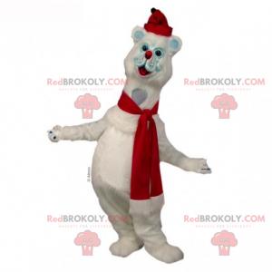 Schneekatzenmaskottchen mit Schal und roter Mütze -