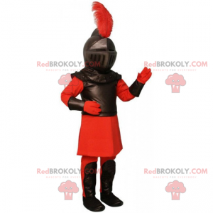 Rittermaskottchen in roter und schwarzer Rüstung -
