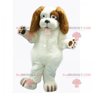 Weißes Hundemaskottchen mit langen braunen Ohren -