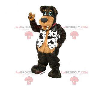 Schwarzes Hundemaskottchen mit schwarz-weißer Jacke -