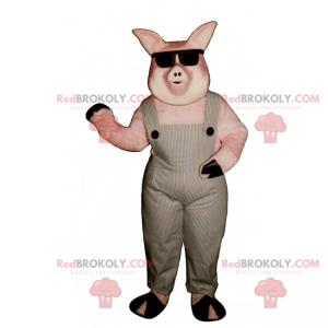 Schweinemaskottchen in Overalls und dunklen Gläsern -