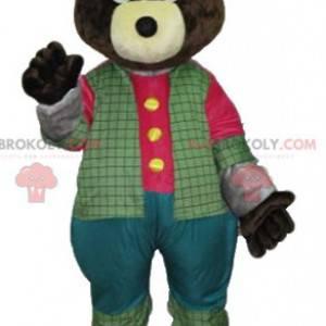 Dark brown bear mascot in colorful outfit - Redbrokoly.com