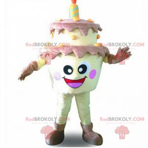 Mascote do bolo de aniversário com uma cara sorridente -