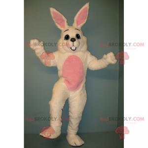 Weißes Kaninchenmaskottchen mit einem rosa Bauch -