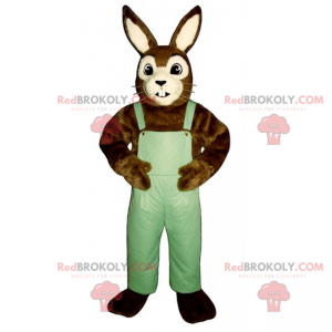 Braunes und weißes Kaninchenmaskottchen mit Overalls -