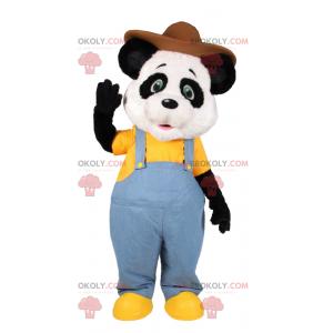 Panda-Maskottchen in blauem Overall und braunem Hut -