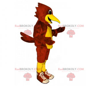 Mascotte pappagallo rosso e giallo con scarpe da ginnastica -
