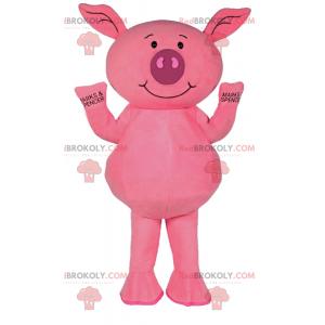 Kleines rosa Schweinemaskottchen lächelnd - Redbrokoly.com
