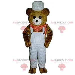 Mascot liten brunbjørn med kjeledress og bandana -
