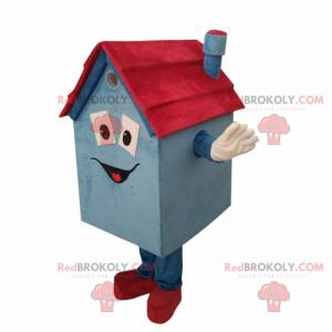 Maskottchen kleines blaues und rotes Haus mit einem Lächeln -