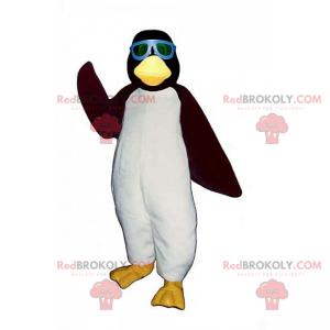 Pingwin maskotka z niebieskimi okularami przeciwsłonecznymi -
