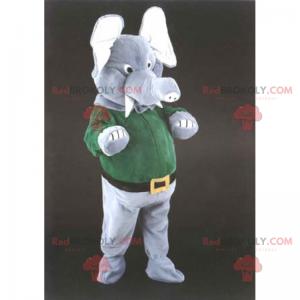 Elefantenmaskottchen in Hose und grünem Pullover -