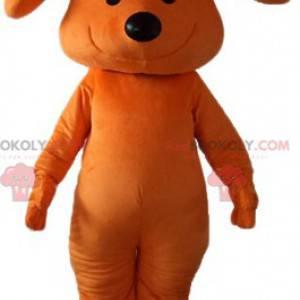 Orange Hundemaskottchen lächelnd mit einem Bogen auf seinem
