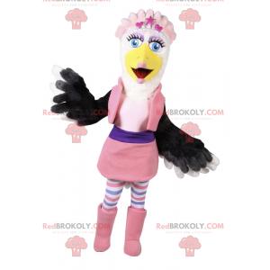 Bílý a černý pták maskot v růžovém glamour oblečení -