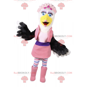 White and black bird mascot in pink glamor outfit -