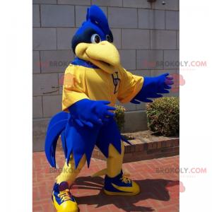 Blaues Vogelmaskottchen in der Sportbekleidung - Redbrokoly.com