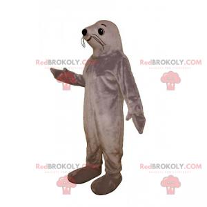 Mascota de león marino sonriente - Redbrokoly.com