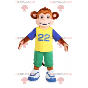 Mascot little monkey smiling in green Bermuda shorts -