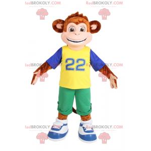 Maskot malá opice s úsměvem v zelených bermudách -