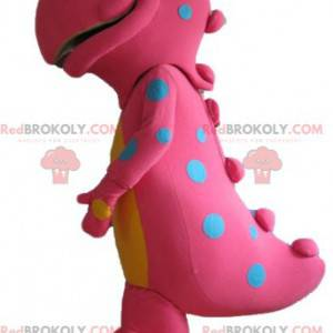 Big pink and yellow dinosaur mascot with blue dots -