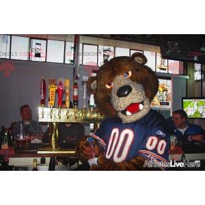 Brown bear mascot with a blue jersey - Redbrokoly.com