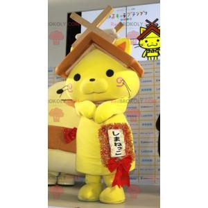 Maskot žlutá kočka se střechou domu na hlavě - Redbrokoly.com