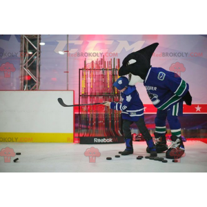 Black and white killer whale mascot in hockey gear -