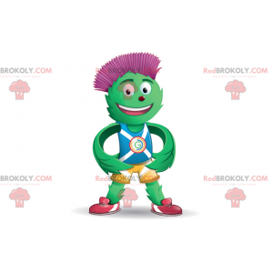 Green and red artichoke mascot in blue and yellow outfit -