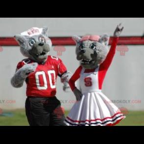 2 graue Wolf Maskottchen in rot und weiß gekleidet -