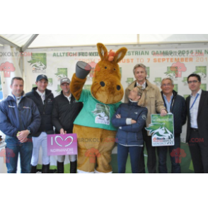 Brown horse mascot in green outfit - Redbrokoly.com
