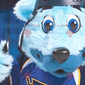 Modrý medvěd maskot s modrýma očima v sportovní oblečení -