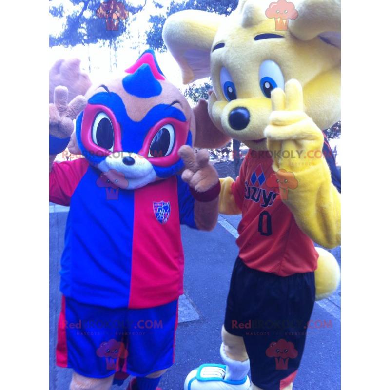 2 maskoti: žlutý medvěd a modré a červené maskované zvíře -