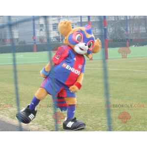 2 mascots: a yellow bear and a blue and red masked animal -