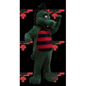 Zelený krokodýlí dinosaurus maskot pruhovaný s černou a