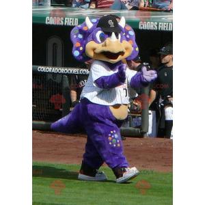 Purple dragon dinosaur mascot with colorful polka dots -