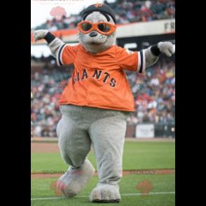 Gray sea lion mascot with an orange t-shirt - Redbrokoly.com