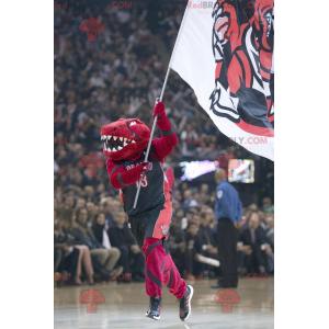 Maskot červený dinosaurus ve sportovním oblečení -