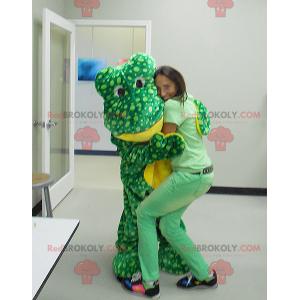Mascote sapo verde e amarelo com pontos - Redbrokoly.com