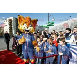 Orange lynx maskot med blå øjne - Redbrokoly.com